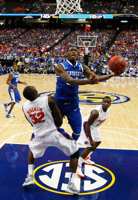 ATLANTA, GA - MARCH 13:  Deandre Liggins #34 of the Kentucky Wildcats shoots against Vernon Macklin #32 of the Florida Gators during the championship game of the SEC Men's Basketball Tournament at Georgia Dome on March 13, 2011 in Atlanta, Georgia. The Wi