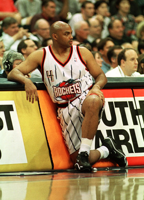 19 Apr 2000:  Forward Charles Barkley #4 of the Houston Rockets watches the action from the scorers table during his final NBA game at the Houston Summit in Houston, Texas. The Grizzlies won the game 96-92. Mandatory Credit: George Wong/ALLSPORT
