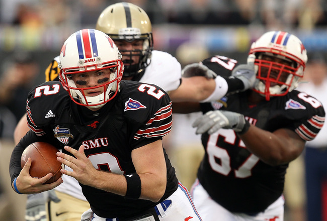 DALLAS, TX - DECEMBER 30:  Quarterback Kyle Padron #2 of the SMU Mustangs runs the ball against the Army Black Knights during the Bell Helicopter Armed Forces Bowl at Gerald J. Ford Stadium on December 30, 2010 in Dallas, Texas.  (Photo by Ronald Martinez