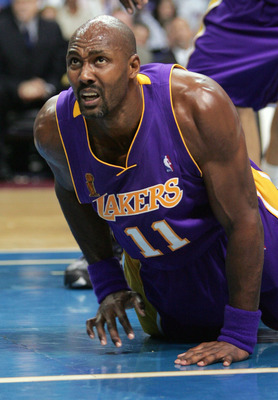 AUBURN HILLS, MI - JUNE 10:  Karl Malone #11 of the Los Angeles Lakers reacts after a play against the Detroit Pistons during the second quarter of game three of the 2004 NBA Finals June 10, 2004 at The Palace of Auburn Hills in Auburn Hills, Michigan.  N