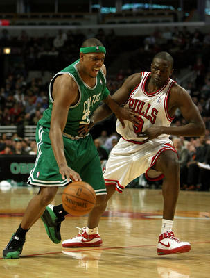CHICAGO, MI - APRIL 01:  Paul Pierce #34 of the Boston Celtics drives against Luol Deng #9 of the Chicago Bulls on April 1, 2008 at the United Center in Chicago, Illinois.  NOTE TO USER: User expressly acknowledges and agrees that, by downloading and or u