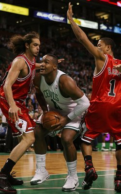 BOSTON - MAY 02:  Glen Davis #11 of the Boston Celtics makes his way through Joakim Noah #13 and Derrick Rose #1 of the Chicago Bulls in Game Seven of the Eastern Conference Quarterfinals during the 2009 NBA Playoffs at TD Banknorth Garden on May 2, 2009