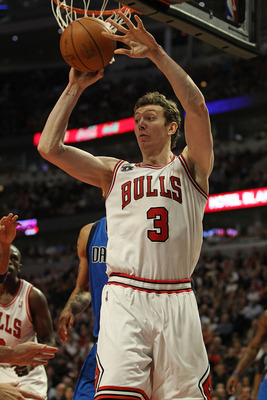 CHICAGO, IL - JANUARY 20: Omer Asik #3 of the Chicago Bulls passes the ball against the Dallas Mavericks at the United Center on January 20, 2011 in Chicago, Illinois. The Bulls defeated the Mavericks 82-77. NOTE TO USER: User expressly acknowledges and a