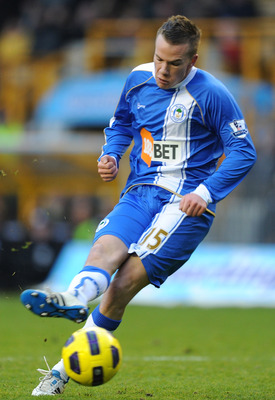 WOLVERHAMPTON, ENGLAND - DECEMBER 26: Tom Cleverley of Wigan Athletic scores his side's second goal during the Barclays Premier League match between Wolverhampton Wanderers and Wigan Athletic at Molineux on December 26, 2010 in Wolverhampton, England.  (P