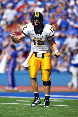 LAWRENCE, KS - SEPTEMBER 26:  Quarterback Austin Davis #12 of the Southern Mississippi Golden Eagles reacts during the game against the Kansas Jayhawks on September 26, 2009 at Memorial Stadium in Lawrence, Kansas.  (Photo by Jamie Squire/Getty Images)