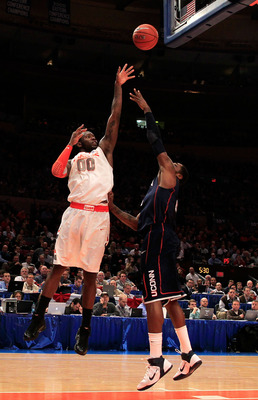 NEW YORK, NY - MARCH 11: Rick Jackson #0 of the Syracuse Orange shoots over Alex Oriakhi #34 of the Connecticut Huskies during the semifinals of the 2011 Big East Men's Basketball Tournament presented by American Eagle Outfitters at Madison Square Garden