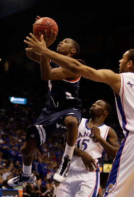 LAWRENCE, KS - DECEMBER 29:  Jonny Rice #4 of the Belmont Bruins shoots as Elijah Johnson #15 and Xavier Henry #1 of the Kansas Jayhawks defend during the game on December 29, 2009 at Allen Fieldhouse in Lawrence, Kansas.  (Photo by Jamie Squire/Getty Ima