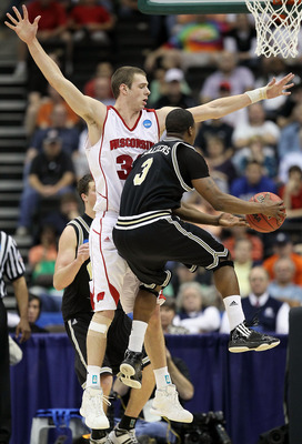 JACKSONVILLE, FL - MARCH 19:  Jon Leuer #30 of the Wisconsin Badgers defends the shot of Junior Salters # 3of the Wofford Terriers during the first round of the 2010 NCAA men's basketball tournament at Jacksonville Veteran's Memorial Arena on March 19, 20