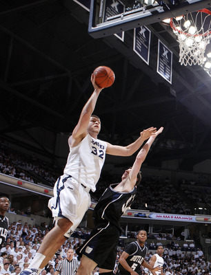 CINCINNATI, OH - DECEMBER 9: Kenny Frease #32 of the Xavier Musketeers goes up for a shot against Matt Howard #54 of the Butler Bulldogs at Cintas Center on December 9, 2010 in Cincinnati, Ohio. Xavier defeated Butler 51-49. (Photo by Joe Robbins/Getty Im