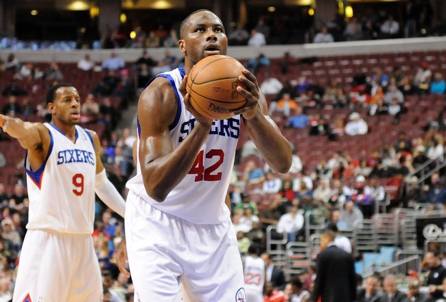 PHILADELPHIA - NOVEMBER 03:  Elton Brand #42 of the Philadelphia 76ers gets set to shoot a free throw as Andre Iguodala #9 gestures to a teammate against the Boston Celtics at the Wachovia Center on November 3, 2009 in Philadelphia, Pennsylvania.  NOTE TO