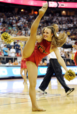 LAS VEGAS, NV - MARCH 12:  A San Diego State Aztecs cheerleader performs during the championship game of the Conoco Mountain West Conference Basketball tournament against the Brigham Young University Cougars at the Thomas & Mack Center March 12, 2011 in L