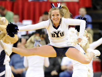 LAS VEGAS, NV - MARCH 12:  A Brigham Young University Cougars cheerleader performs during the championship game of the Conoco Mountain West Conference Basketball tournament against the San Diego State Aztecs at the Thomas & Mack Center March 12, 2011 in L