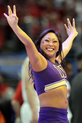 LOS ANGELES, CA - MARCH 12:  A Washington Huskies cheerleader performs during a break in the championship game against the Arizona Wildcats in the 2011 Pacific Life Pac-10 Men's Basketball Tournament at Staples Center on March 12, 2011 in Los Angeles, Cal