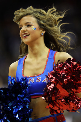 KANSAS CITY, MO - MARCH 10:  A Kansas Jayhawks cheerleader performs during their quarterfinal game against the Oklahoma State Cowboys in the 2011 Phillips 66 Big 12 Men's Basketball Tournament at Sprint Center on March 10, 2011 in Kansas City, Missouri.