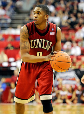 LAS VEGAS, NV - MARCH 11:  Oscar Bellfield #0 of the UNLV Rebels looks to pass during a semifinal game of the Conoco Mountain West Conference Basketball tournament against the San Diego State Aztecs at the Thomas & Mack Center March 11, 2011 in Las Vegas,