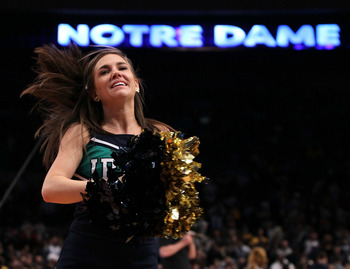 NEW YORK - MARCH 11:  The Notre Dame Fighting Irish cheerleaders perform on the court against the Pittsburgh Panthers during the quarterfinal of the 2010 NCAA Big East Tournament at Madison Square Garden on March 11, 2010 in New York City.  (Photo by Jim