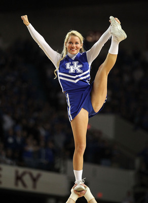 LOUISVILLE, KY - DECEMBER 08:  A Kentucky Wildcats cheerleader performs during the game against the Notre Dame Fighting Irish in the 2010 DIRECTV SEC/BIG EAST Invitational at Freedom Hall on December 8, 2010 in Louisville, Kentucky.  (Photo by Andy Lyons/