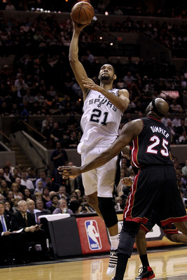 SAN ANTONIO, TX - MARCH 04:  Forward Tim Duncan #21 of the San Antonio Spurs takes a shot against Erick Dampier #25 of the Miami Heat at AT&amp;T Center on March 4, 2011 in San Antonio, Texas.   NOTE TO USER: User expressly acknowledges and agrees that, by do