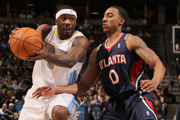 DENVER, CO - FEBRUARY 28:  Ty Lawson #3 of the Denver Nuggets drives the ball against Jeff Teague #0 of the Atlanta Hawks during NBA action at the Pepsi Center on February 28, 2011 in Denver, Colorado. NOTE TO USER: User expressly acknowledges and agrees