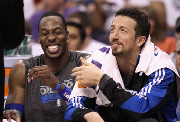 PHOENIX, AZ - MARCH 13:  Dwight Howard #12 and Hedo Turkoglu #15 of the Orlando Magic laugh on the bench during the NBA game against the Phoenix Suns at US Airways Center on March 13, 2011 in Phoenix, Arizona. The Magic defeated the Suns 111-88.  NOTE TO