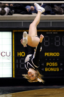 WEST LAFAYETTE, IN - JANUARY 09:  A cheerleader for the Purdue Boilermakers performs against the Iowa Hawkeyes at Mackey Arena on January 9, 2011 in West Lafayette, Indiana.  (Photo by Chris Chambers/Getty Images)