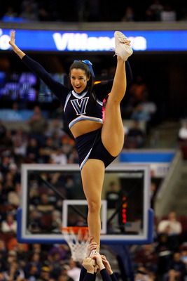 PHILADELPHIA - MARCH 19:  A Villanova Wildcats cheerleader performs during the game against the American Eagles during the first round of the NCAA Division I Men's Basketball Tournament at the Wachovia Center on March 19, 2009 in Philadelphia, Pennsylvani