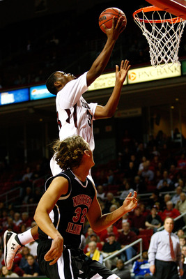 PHILADELPHIA, PA - DECEMBER 18: Scootie Randall #33 of the Temple Owls drives for a shot attempt against Aksel Bolin #32 of the Northern Illinois Huskies at the Liacouras Center on December 18, 2010 in Philadelphia, Pennsylvania. (Photo by Chris Chambers/