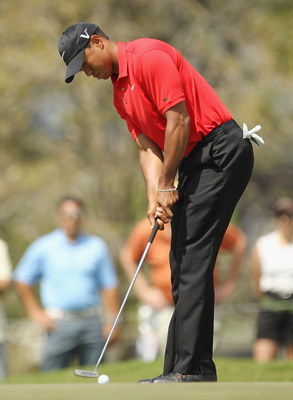 DORAL, FL - MARCH 13:  Tiger Woods hits a putt during the final round of the 2011 WGC- Cadillac Championship at the TPC Blue Monster at the Doral Golf Resort and Spa on March 13, 2011 in Doral, Florida.  (Photo by Mike Ehrmann/Getty Images)
