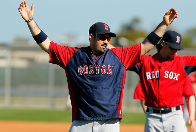 FORT MYERS, FL - FEBRUARY 19:  First baseman Adrian Gonzalez #28 of the Boston Red Sox stretches during a Spring Training Workout Session at the Red Sox Player Development Complex on February 19, 2011 in Fort Myers, Florida.  (Photo by J. Meric/Getty Imag