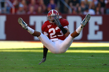 TUSCALOOSA, AL - NOVEMBER 07:  Robby Green #23 of the Alabama Crimson Tide falls to the ground after a near interception against the Louisiana State University Tigers at Bryant-Denny Stadium on November 7, 2009 in Tuscaloosa, Alabama.  (Photo by Kevin C.
