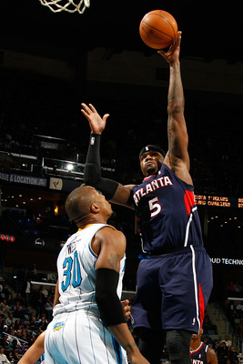NEW ORLEANS, LA - DECEMBER 26:  Josh Smith #5 of the Atlanta Hawks shoots the ball over David West #30 of the New Orleans Hornets at the New Orleans Arena on December 26, 2010 in New Orleans, Louisiana.  The Hornets defeated the Hawks 93-86.  NOTE TO USER