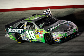 BRISTOL, TN - AUGUST 21:  Kyle Busch, driver of the #18 Doublemint Toyota, celebrates on track after winning the NASCAR Sprint Cup Series IRWIN Tools Night Race at Bristol Motor Speedway on August 21, 2010 in Bristol, Tennessee.  (Photo by Getty Images/Ge