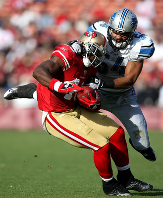 SAN FRANCISCO - DECEMBER 27:  Delanie Walker #46 of the San Francisco 49ers is tackled by DeAndre Levy #54 of the Detroit Lions during an NFL game at Candlestick Park on December 27, 2009 in San Francisco, California.  (Photo by Jed Jacobsohn/Getty Images