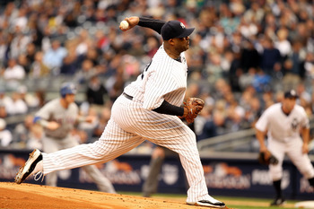 NEW YORK - OCTOBER 20:  CC Sabathia #52 of the New York Yankees pitches against the Texas Rangers in Game Five of the ALCS during the 2010 MLB Playoffs at Yankee Stadium on October 20, 2010 in the Bronx borough of New York City.  (Photo by Al Bello/Getty