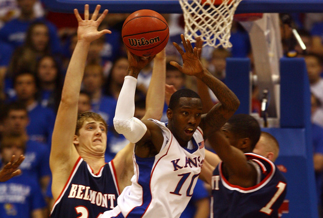 LAWRENCE, KS - DECEMBER 29:  Tyshawn Taylor #10 of the Kansas Jayhawks passes during the game against the Belmont Bruins on December 29, 2009 at Allen Fieldhouse in Lawrence, Kansas.  (Photo by Jamie Squire/Getty Images)