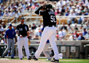 GLENDALE, AZ - MARCH 11:  Pitcher Mark Buehrle #56 of the Chicago White Sox reacts after giving up a home run to Geovany Soto #18 of the Chicago Cubs during the spring training baseball game at Camelback Ranch on March 11, 2011 in Glendale, Arizona.  (Pho