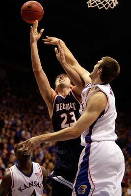 LAWRENCE, KS - DECEMBER 29:  Scott Saunders #23 of the Belmont Bruins is fouled by Jeff Withey #5 of the Kansas Jayhawks during the game on December 29, 2009 at Allen Fieldhouse in Lawrence, Kansas.  (Photo by Jamie Squire/Getty Images)