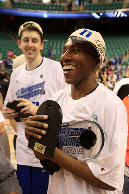 GREENSBORO, NC - MARCH 13:  Nolan Smith #2 of the Duke Blue Devils celebrates after being named MVP and defeating the North Carolina Tar Heels 75-58 in the championship game of the 2011 ACC men's basketball tournament at the Greensboro Coliseum on March 1