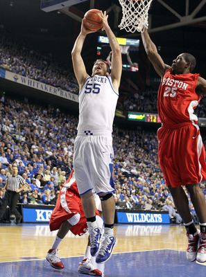 LEXINGTON, KY - NOVEMBER 30: Josh Harrellson #55 of the Kentucky Wildcats shoots the ball while defended by Patrick Hazel #25 of the Boston University Terriers during the game on November 30, 2010 in Lexington, Kentucky. Kentucky won 91-57. (Photo by Andy