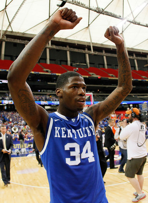ATLANTA, GA - MARCH 13:  Deandre Liggins #34 of the Kentucky Wildcats celebrates their 70 to 54 win over the Florida Gators in the championship game of the SEC Men's Basketball Tournament at Georgia Dome on March 13, 2011 in Atlanta, Georgia.  (Photo by K