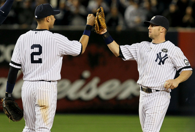 NEW YORK - OCTOBER 09:  (L-R) Derek Jeter #2 and Brett Gardner #11 of the New York Yankees celebrate after their 6-1 win against the Minnesota Twins during Game Three of the ALDS part of the 2010 MLB Playoffs at Yankee Stadium on October 9, 2010 in the Br