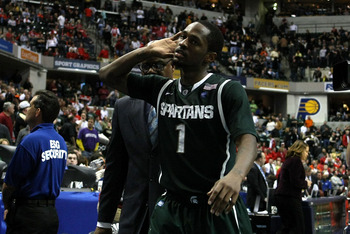 INDIANAPOLIS, IN - MARCH 11:  Kalin Lucas #1 of the Michigan State Spartans calls on the fans as he wals off the court after Michigan State won 74-56 against the Purdue Boilermakers during the quarterfinals of the 2011 Big Ten Men's Basketball Tournament