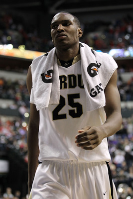 INDIANAPOLIS, IN - MARCH 11:  JaJuan Johnson #25 of the Purdue Boilermakers walks off the court dejected after they lost 74-56 against the Michigan State Spartans during the quarterfinals of the 2011 Big Ten Men's Basketball Tournament at Conseco Fieldhou