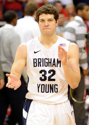 LAS VEGAS, NV - MARCH 11:  Jimmer Fredette #32 of the Brigham Young University Cougars claps after he scored 52 points in the team's 87-76 victory over the New Mexico Lobos in a semifinal game of the Conoco Mountain West Conference Basketball tournament a