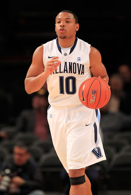NEW YORK, NY - MARCH 08: Corey Fisher #10 of the Villanova Wildcats brings the ball up court against the South Florida Bulls during the first round of the 2011 Big East Men's Basketball Tournament presented by American Eagle Outfitters at Madison Square G