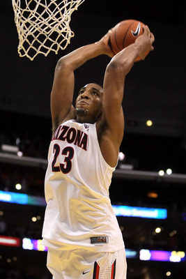 LOS ANGELES, CA - MARCH 11:  Derrick Williams #23 of the Arizona Wildcats dunks the ball to end the first half while taking on the USC Trojans in the semifinals of the 2011 Pacific Life Pac-10 Men's Basketball Tournament at Staples Center on March 11, 201
