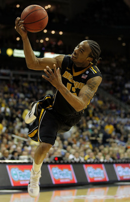 KANSAS CITY, MO - MARCH 10:  Marcus Denmon #12 of the Missouri Tigers throws a shot up against the Texas A&amp;M Aggies during their quarterfinal game in the 2011 Phillips 66 Big 12 Men's Basketball Tournament at Sprint Center on March 10, 2011 in Kansas City