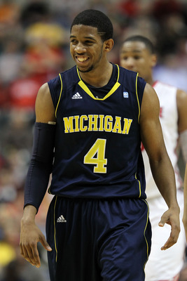 INDIANAPOLIS, IN - MARCH 12:  Darius Morris #4 of the Michigan Wolverines looks on against the Ohio State Buckeyes during the semifinals of the 2011 Big Ten Men's Basketball Tournament at Conseco Fieldhouse on March 12, 2011 in Indianapolis, Indiana.  (Ph