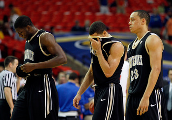ATLANTA, GA - MARCH 12:  Lance Goulbourne #5, Festus Ezeli #3 and John Jenkins #23 of the Vanderbilt Commodores walk off of the court dejected after loosing to the Florida Gators 77 to 66 during the semifinals of the SEC Men's Basketball Tournament at Geo