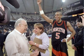 14 Mar 1996:  Guard Sydney Johnson and coach Pete Carril of the Princeton Tigers celebrate after a game against the UCLA Bruins at the RCA Dome in Indianapolis, Indiana.  Princeton won the game, 43-41. Mandatory Credit: Jamie Squire  /Allsport